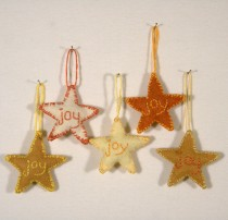 "These 2"" felt star ornaments are hand-embroidered and lightly stuffed. The workshop will feature a hot-glued version that you can embellish as you like--how about glitter glue? (Embroidery is allowed but not mandatory.)"
